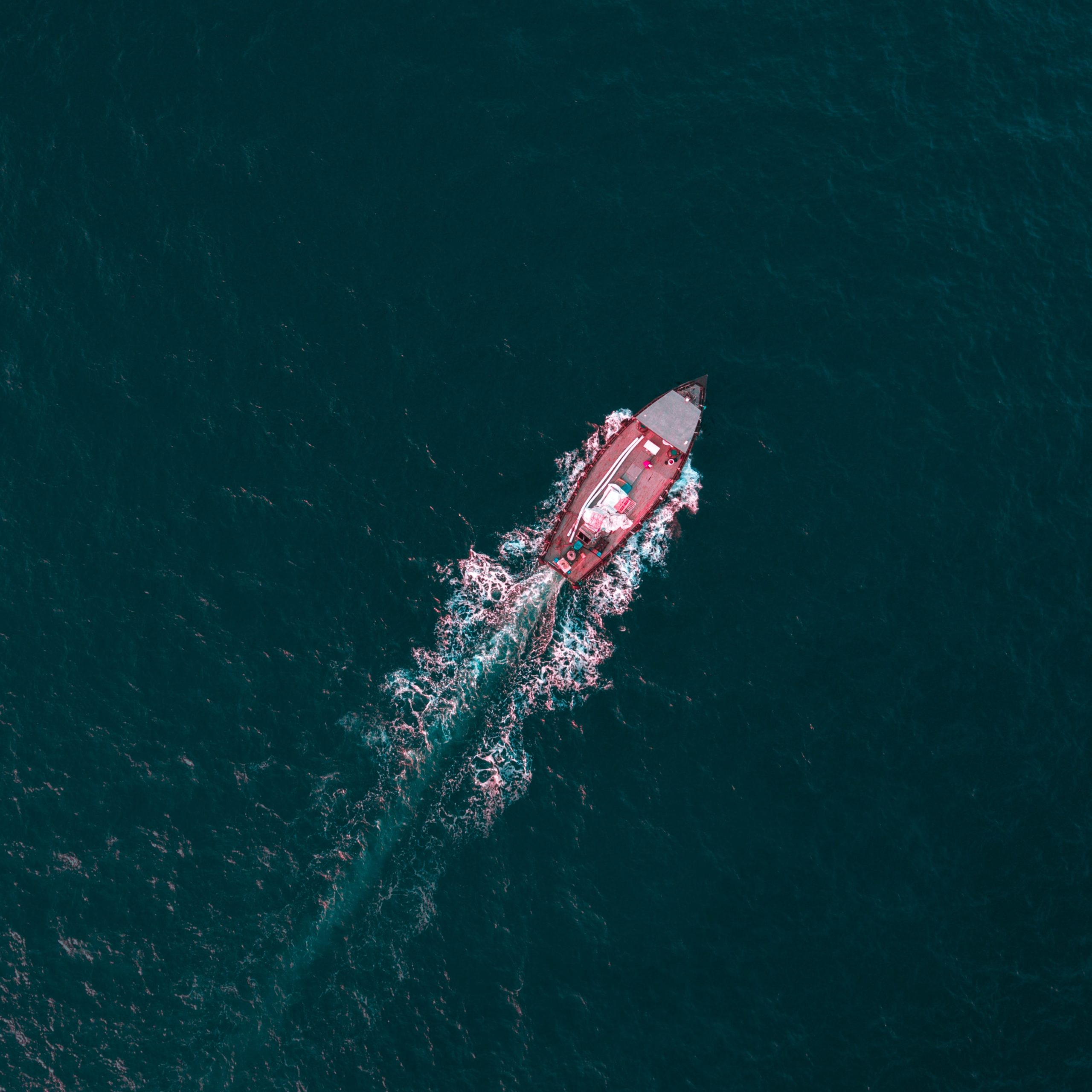 aerial view of boat on calm body of water