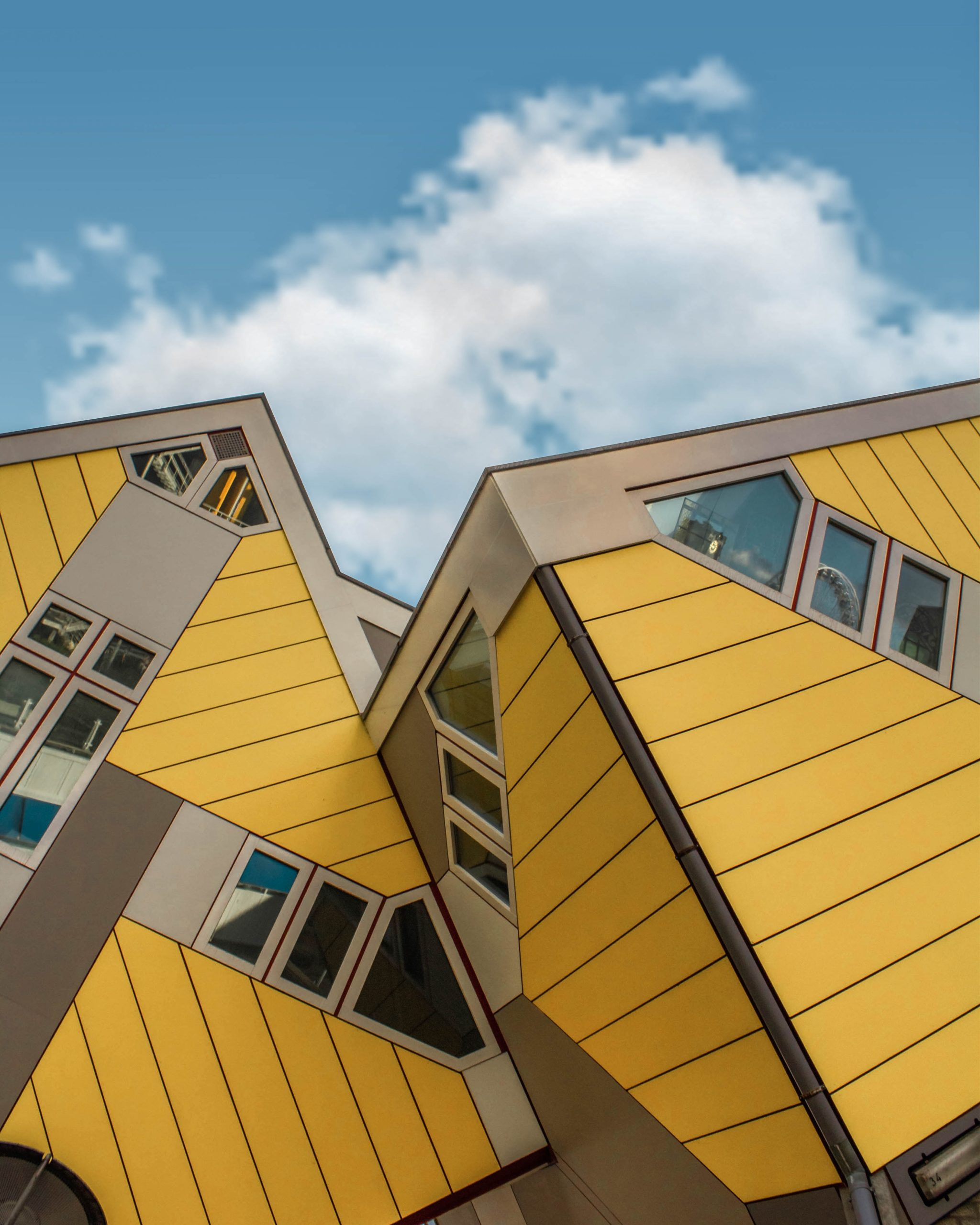 architectural photography of yellow and gray house roof