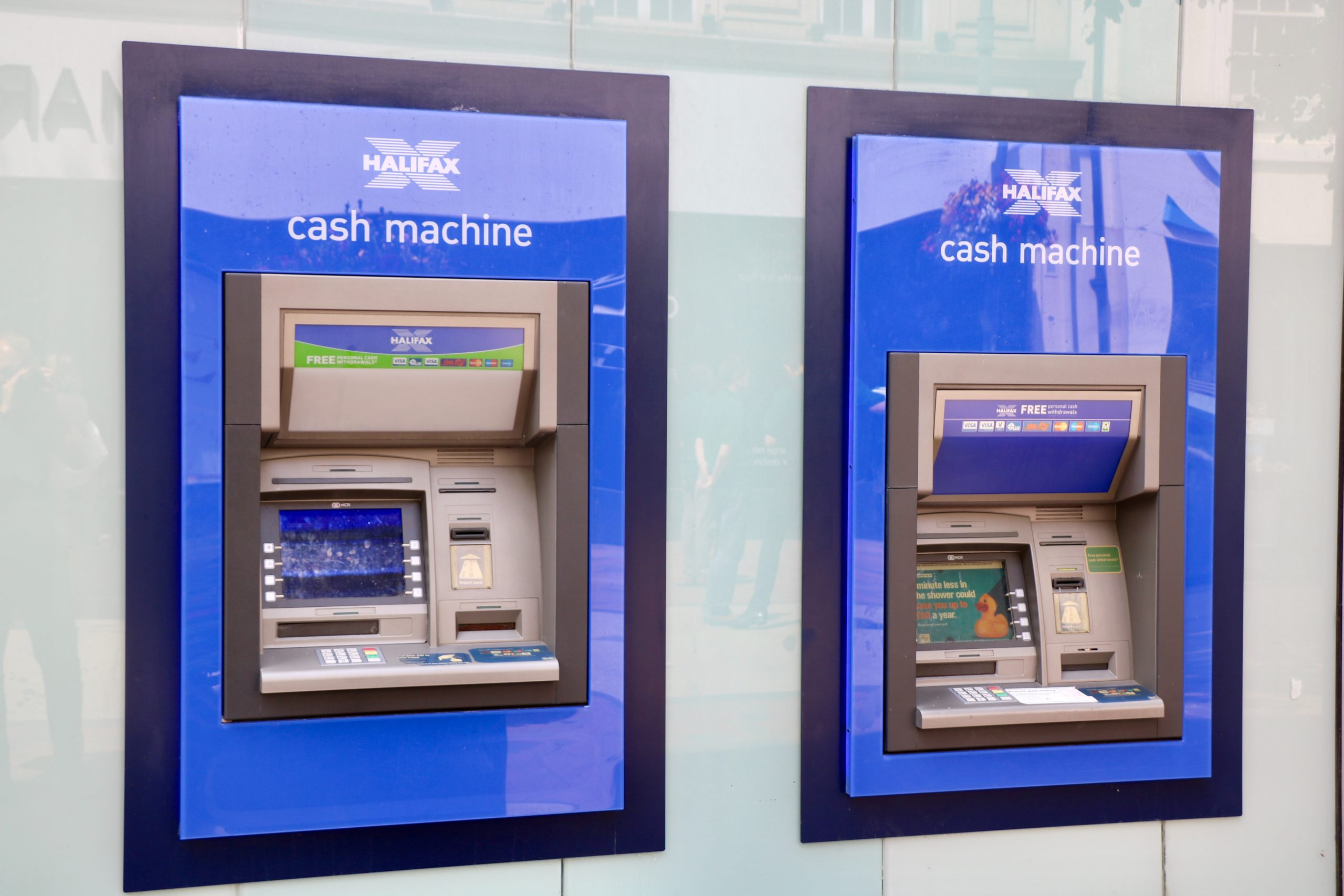 two blue and black Halifax Cash Machines